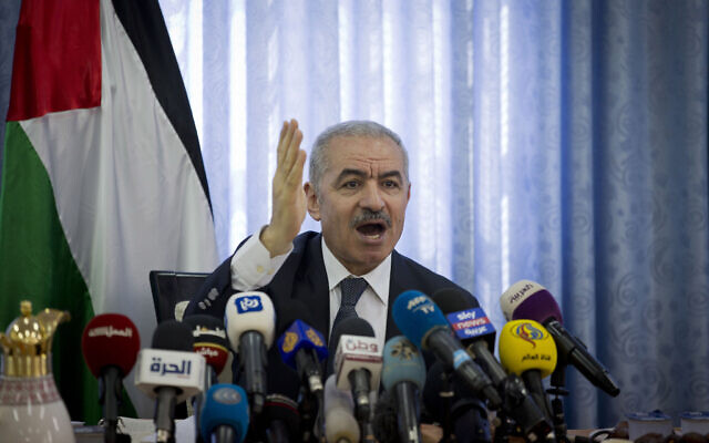 Palestinian Authority Prime Minister Mohammad Shtayyeh, chairs a cabinet meeting in the Jordan Valley village of Fasayil, September 16, 2019. (Majdi Mohammed/AP)