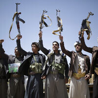 In this September 21, 2019 file photo, Shiite Houthi tribesmen hold their weapons as they chant slogans during a tribal gathering showing support for the Houthi movement, in Sanaa, Yemen. (AP Photo/Hani Mohammed)