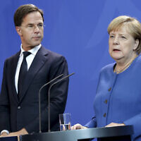 German Chancellor Angela Merkel, right, and Dutch Prime Minister Mark Rutte, left, address the media during a joint press conference as part of a government meeting at the Chancellery in Berlin on October 2, 2019. (AP Photo/Michael Sohn)