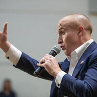 U.S. Rep. Max Rose speaks to constituents during a town hall meeting, Wednesday, Oct. 2, 2019, at the Joan and Alan Bernikow Jewish Community Center in the Staten Island borough of New York. (AP Photo/Mary Altaffer)