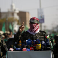 A spokesman for the armed wing of Gaza-ruling Hamas terror group talks to the press in the town of Khan Younis, southern Gaza Strip, November 11, 2019. (AP Photo/ Hatem Moussa)