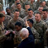 Vice President Mike Pence greets troops at Al Asad Air Base, Iraq, November 23, 2019. (AP Photo/Andrew Harnik)