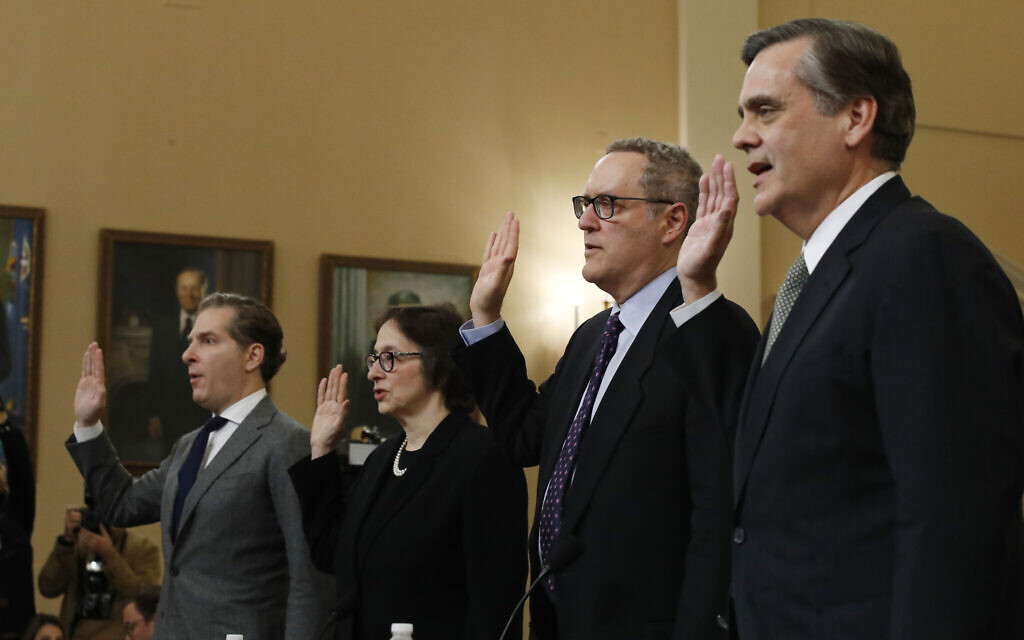 From left, Constitutional law experts, Harvard Law School professor Noah Feldman, Stanford Law School professor Pamela Karlan, University of North Carolina Law School professor Michael Gerhardt and George Washington University Law School professor Jonathan Turley are sworn in before testifying during a hearing before the House Judiciary Committee on the constitutional grounds for the impeachment of President Donald Trump, on Capitol Hill in Washington, Wednesday, December 4, 2019. (AP Photo/Alex Brandon)