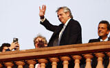 Argentina's President Alberto Fernandez waves to supporters from the terrace of the presidential palace in Buenos Aires, Argentina, December 10, 2019. (AP Photo/Marcos Brindicci)