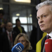 Lithuanian President Gitanas Nauseda speaks with the media as he arrives for an EU summit in Brussels, December 12, 2019. (AP Photo/Olivier Matthys)