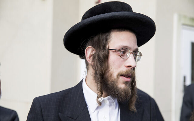 Josef Gluck talks to members of the media about how he obstructed the assailant during a stabbing attack during Hanukkah at a rabbi's home, December 29, 2019, in Monsey, New York. (AP Photo/Julius Constantine Motal)