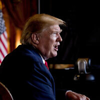 In this Dec. 24, 2019 photo, President Donald Trump speaks to members of the media following a Christmas Eve video teleconference with members of the military at his Mar-a-Lago estate in Palm Beach, Fla.  (AP Photo/Andrew Harnik)