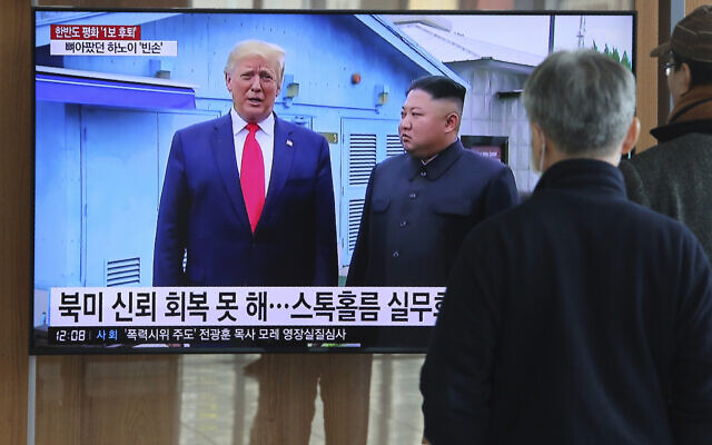 People watch a TV screen showing a file image of North Korean leader Kim Jong Un and US President Donald Trump, left, during a news program at the Seoul Railway Station in Seoul, South Korea, Tuesday, Dec. 31, 2019. (AP Photo/Ahn Young-joon)
