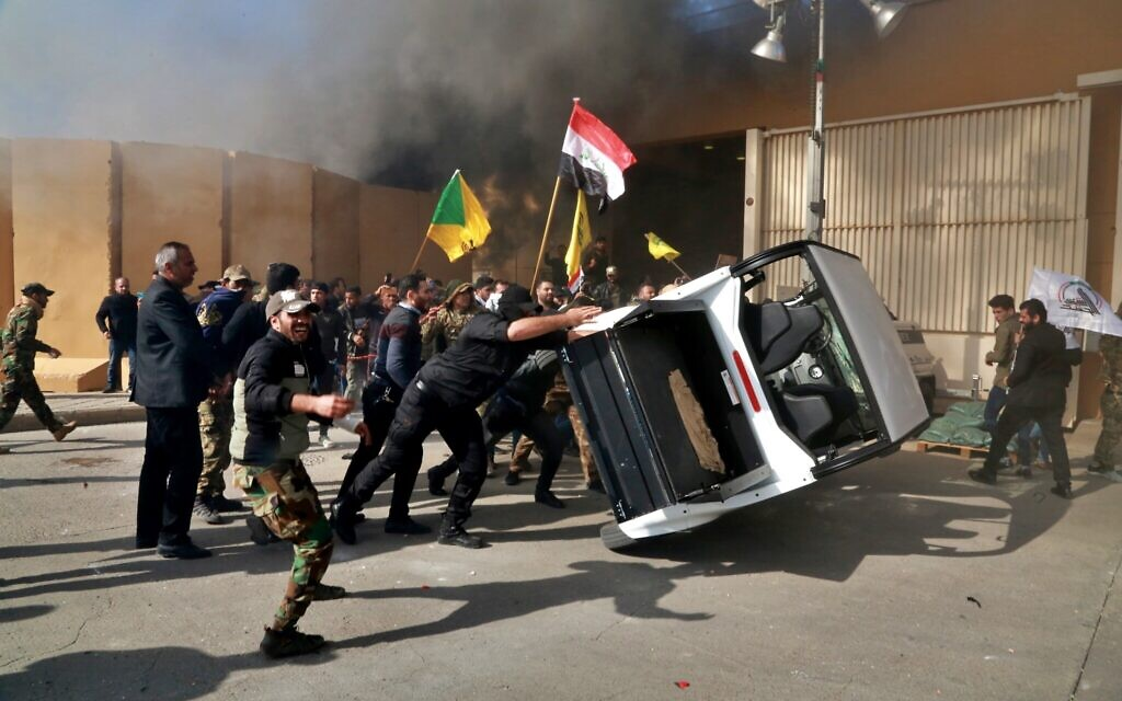 Protesters damage property inside the US embassy compound, in Baghdad, Iraq, December 31, 2019. (AP Photo/Khalid Mohammed)
