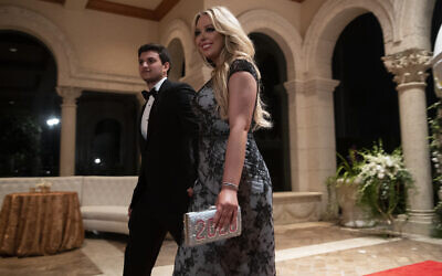 Tiffany Trump, the daughter of US President Donald Trump, and her boyfriend Michael Charbel Boulous arrive for a New Year's Eve party at the president's Mar-a-Lago property, December 31, 2019, in Palm Beach, Fla. (AP Photo/ Evan Vucci)