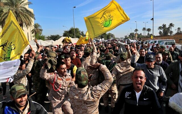 Pro-Iranian militiamen and their supporters chant slogans against the U.S. in front of the U.S. embassy in Baghdad, Iraq, Wednesday, Jan. 1, 2020. (AP/Khalid Mohammed)