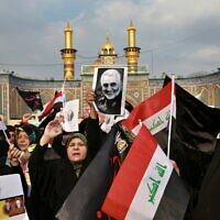 Shiite Muslims demonstrate over the US airstrike that killed Iranian Revolutionary Guard Gen. Qassem Soleimani, in the posters, in Karbala, Iraq,  Jan. 4, 2020 (AP Photo/Khalid Mohammed)