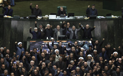 Iranian lawmakers chant anti-American and anti-Israeli slogans to protest against the US killing of Iranian top general Qassem Soleimani, at the start of an open session of parliament in Tehran, Iran, January 5, 2020. (Mohammad Hassanzadeh/Tasnim News Agency via AP)