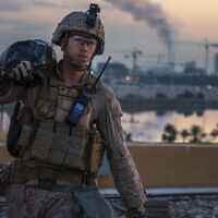 US Marine carries a sand bag during the reinforcement of the US embassy compound in Baghdad, Iraq, January 4, 2020. (US Marine Corps photo by Sgt. Kyle C. Talbot via AP)