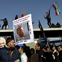 Mourners attend a funeral ceremony for Iranian Gen. Qassem Soleimani and his comrades, who were killed in Iraq in a US drone strike, at the Enqelab-e-Eslami (Islamic Revolution) square in Tehran, Iran, January 6, 2020. (Ebrahim Noroozi/AP)
