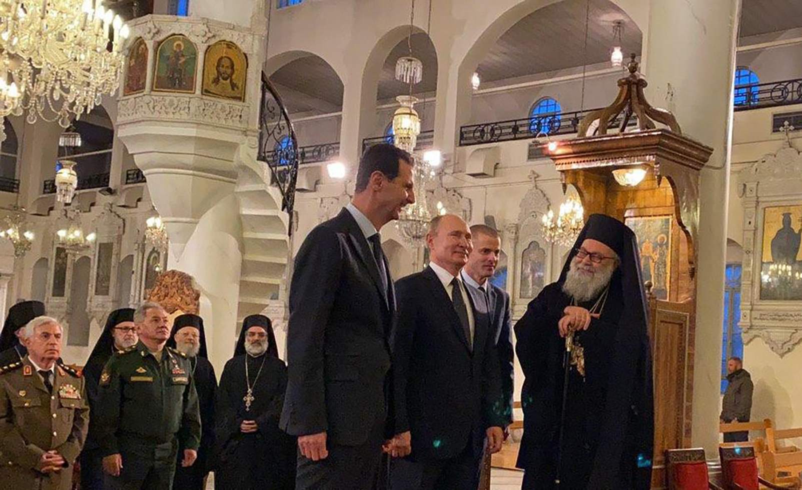 New York Orthodox Church Christmas 2020 Putin jokes to Assad he should host Trump; Syrian leader says he's
