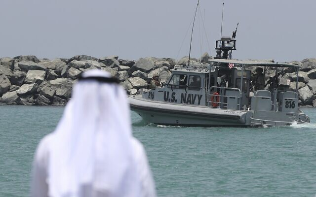 In this June 19, 2019 file photo, a U.S. Navy patrol boat carrying journalists to see damaged oil tankers leaves a US Navy 5th Fleet base, near Fujairah, United Arab Emirates (AP Photo/Kamran Jebreili, File)