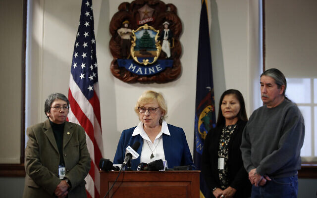 Maine Gov. Janet Mills speaks to reporters before signing papers to posthumously pardon Don Gellers, a Passamaquoddy tribal lawyer convicted of marijuana possession, at the Statehouse in Augusta, Maine, January 7, 2020. (Robert F. Bukaty/AP)
