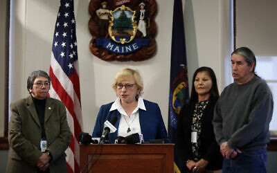 Maine Gov. Janet Mills speaks to reporters before signing papers to posthumously pardon Don Gellers, a Passamaquoddy tribal lawyer convicted of marijuana possession, Tuesday, Jan. 7, 2020 at the Statehouse in Augusta, Maine. Accompanying the governor, from left, is Donna Loring, the governor's senior adviser on tribal affairs, Tribal Rep. Rena Newell, and Darrell Newell, Vice Chief of the Passamaquoddy Indian Township. (AP Photo/Robert F. Bukaty)