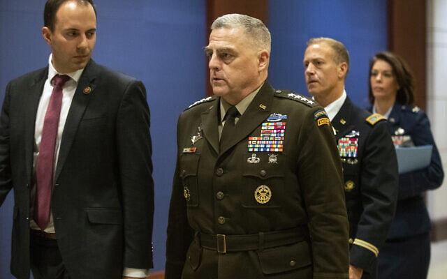 Joint Chiefs of Staff Chairman Gen. Mark Milley, center, walks towards the Senate after briefing members of Congress on last week's targeted killing of Iran's senior military commander Gen. Qassem Soleimani, Wednesday, Jan. 8, 2020, on Capitol Hill in Washington. (AP Photo/Manuel Balce Ceneta)