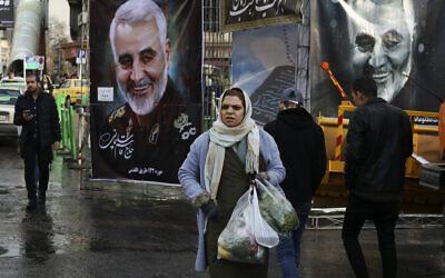 Pedestrians walk past banners of Iranian Revolutionary Guard Gen. Qassem Soleimani, who was killed in Iraq in a U.S. drone attack on Friday, in Tajrish square in northern Tehran, Iran, Thursday, Jan. 9, 2020. (AP/Vahid Salemi)