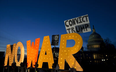 Demonstrators protest outside of the U.S. Capitol, during a house vote to measure limiting President Donald Trump's ability to take military action against Iran, on Capitol Hill, in Washington, Thursday, Jan. 9, 2020. (AP/Jose Luis Magana)