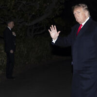 US President Donald Trump waves after stepping off Marine One on the South Lawn of the White House, in Washington, January 9, 2020. (Alex Brandon/AP)