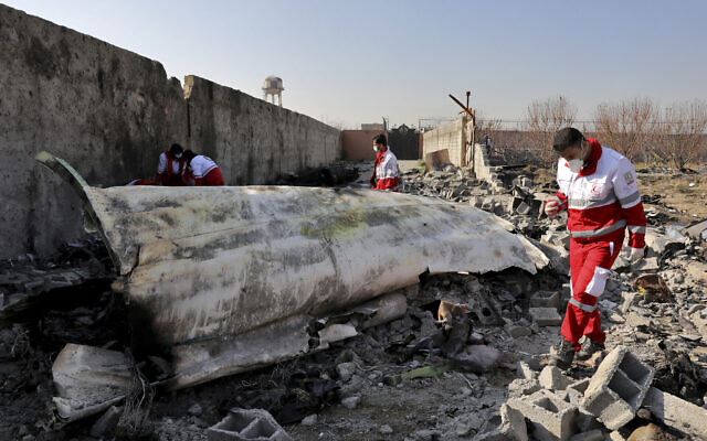 In this photo from January 8, 2020 photo, rescue workers search the scene where a Ukrainian plane crashed in Shahedshahr, southwest of the capital Tehran, Iran. (AP Photo/Ebrahim Noroozi)