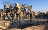 US soldiers stand at the site of an Iranian bombing at Ain al-Asad air base in Anbar, Iraq, Monday, Jan. 13, 2020. (AP/Qassim Abdul-Zahra)