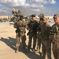 US soldiers stand at a site of Iranian bombing at Ain al-Asad air base in Anbar, Iraq, January 13, 2020. (AP Photo/Qassim Abdul-Zahra)