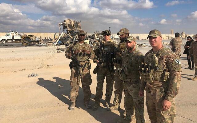 US soldiers stand at a site of Iranian bombing at Ain al-Asad air base in Anbar, Iraq, January 13, 2020. (AP Photo/Qassim Abdul-Zahra)