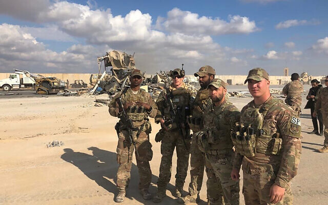 US Soldiers stand at a site of Iranian bombing at Ain al-Asad air base in Anbar, Iraq, Monday, Jan. 13, 2020. (AP/Qassim Abdul-Zahra)