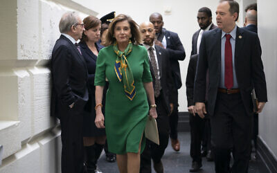 Speaker of the US House Nancy Pelosi (L), joined by House Intelligence Committee Chairman Adam Schiff, leaves a lengthy closed-door meeting with the Democratic Caucus at the Capitol in Washington, January 14, 2020. (AP Photo/J. Scott Applewhite)