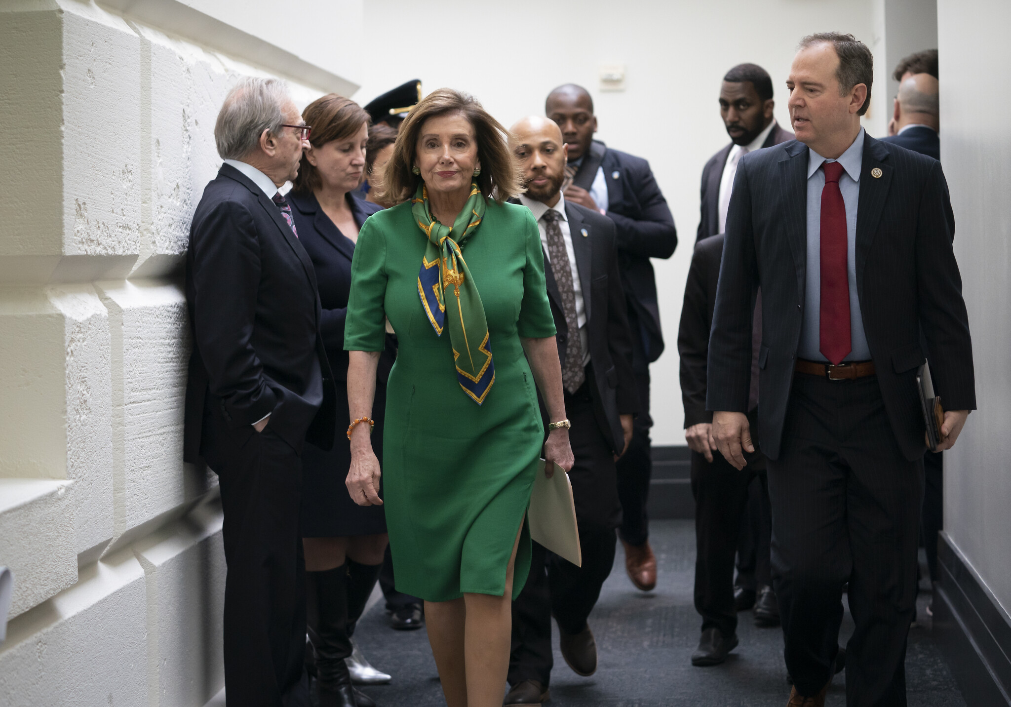 Speaker of the US House Nancy Pelosi, joined by House Intelligence Committee Chairman Adam Schiff leaves a lengthy closed-door meeting with the Democratic Caucus at the Capitol in Washington