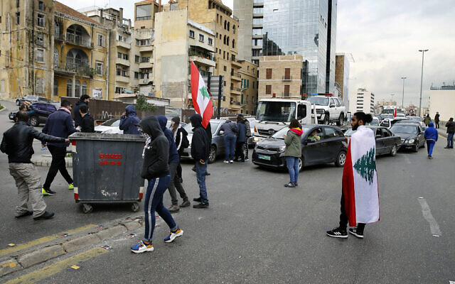 Water cannon, tear gas & scores injured as Lebanese protesters clash with police