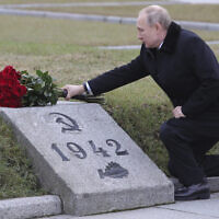 Russian President Vladimir Putin attends a wreath laying commemoration ceremony for the 77th anniversary since the Leningrad siege was lifted during the World War II at the Piskaryovskoye Memorial Cemetery, where hundreds of thousands of siege victims are buried, in St. Petersburg, Russia, January 18, 2020. (Alexei Danichev, Sputnik, Kremlin Pool Photo via AP)