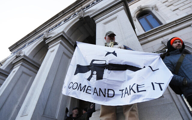 A demonstrator stands outside a court house during a pro-gun rally, Monday, Jan. 20, 2020, in Richmond, Va. (AP/Julio Cortez)
