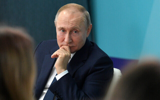 Russian President Vladimir Putin listens for a question as he visits the 'Sirius' Educational Centre in the Black Sea resort of Sochi, Russia, January 22, 2020 (Mikhail Klimentyev, Sputnik, Kremlin Pool Photo via AP)