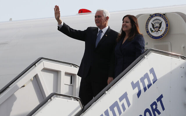 US Vice President Mike Pence waves as he disembarks from a plane with his wife Karen, upon their arrival at Ben Gurion International Airport ,to attend the World Holocaust Forum at the Yad Vashem memorial center, January 23, 2020. (Ammar Awad/Pool Photo via AP)