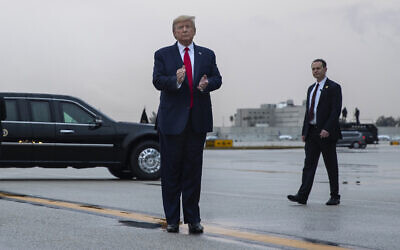 US President Donald Trump pauses as he arrives at Miami International Airport en route to attend the Republican National Committee winter meetings, Thursday, January 23, 2020, in Miami. (AP/ Evan Vucci)