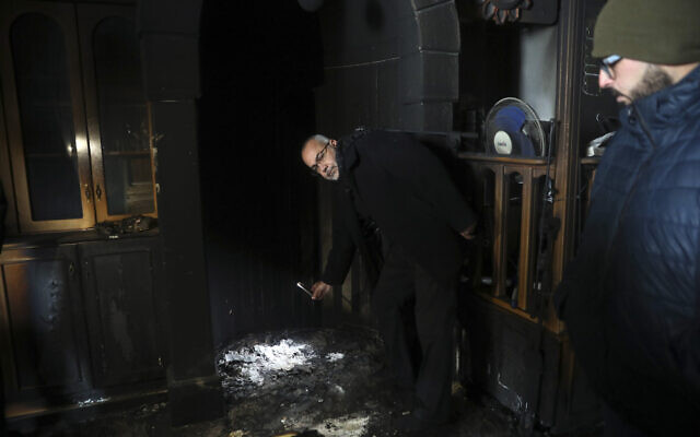 Palestinians visit a torched mosque in the Arab neighborhood of Sharafat in East Jerusalem on January 24, 2020 (AP Photo/Mahmoud Illean)