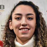 Iranian Taekwondo athlete Kimia Alizadeh speaks to the media at a press conference in Luenen, Germany, January 24, 2020. (AP Photo/Martin Meissner)