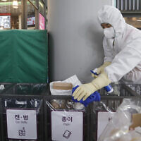 An employee works to prevent the spread of a new coronavirus at Suseo Station in Seoul, South Korea, January 24, 2020. (Ahn Young-joon/AP)
