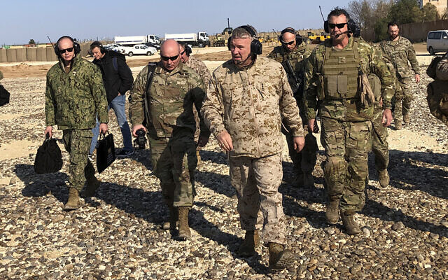 Gen. Frank McKenzie, center front, the top US commander for the Middle East, walks as he visits a military outpost in Syria on January 25, 2020. (AP Photo/Lolita Baldor)
