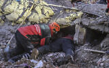 Rescue workers try to save people trapped under debris following a strong earthquake that destroyed several buildings on Friday, in Elazig, eastern Turkey on January 26, 2020. (Ismail Coskun/IHA via AP)
