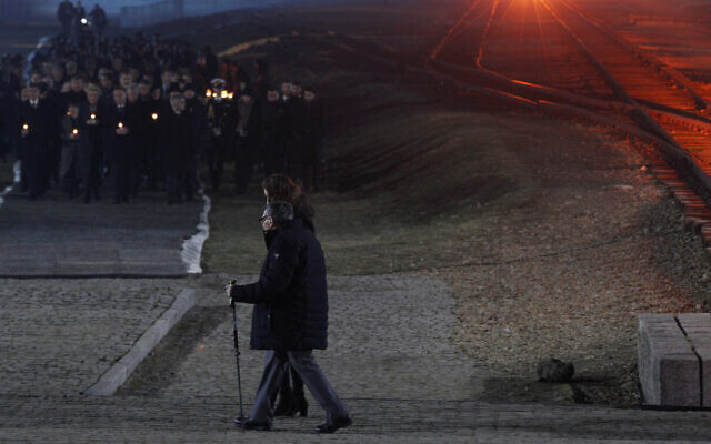 Holocaust survivor Marian Turski, center, walks to meet dignitaries, rear left, during commemorations at the Auschwitz Nazi death camp in Oswiecim, Poland, January 27, 2020. (AP Photo/Czarek Sokolowski)