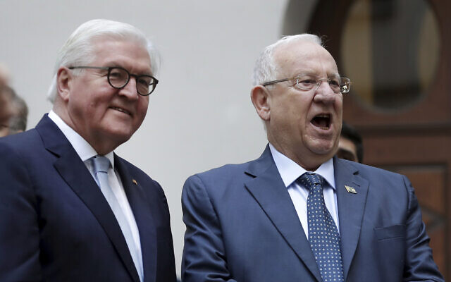 German President Frank-Walter Steinmeier, left, and President Reuven Rivlin, right, sing as they attend a performance of the school choir during their visit at the Moses Mendelssohn school in Berlin, Germany, Jan. 28, 2020. (AP Photo/Michael Sohn, pool)