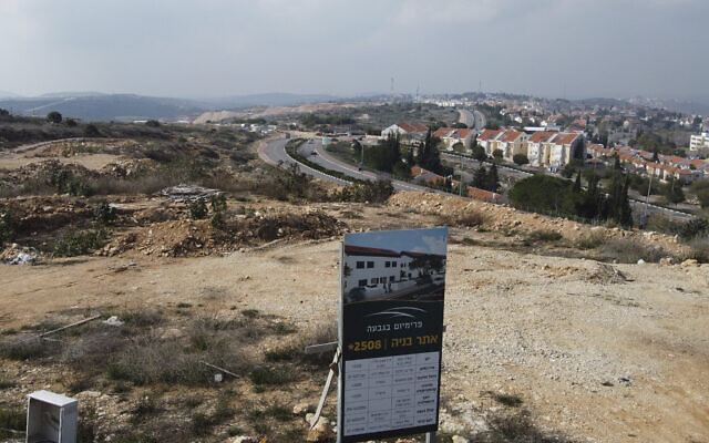 A new housing project sign stands in the Jewish West Bank settlement of Ariel, Tuesday, Jan. 28, 2020. (AP/Ariel Schalit)