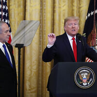 US President Donald Trump (R), joined by Prime Minister Benjamin Netanyahu, speaks during an event in the East Room of the White House in Washington, January 28, 2020, to announce the Trump administration's much-anticipated plan to resolve the Israeli-Palestinian conflict. (AP Photo/Alex Brandon)