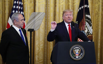 US President Donald Trump (R), joined by Prime Minister Benjamin Netanyahu, speaks during an event in the East Room of the White House in Washington, January 28, 2020, to announce the Trump administration's much-anticipated plan to resolve the Israeli-Palestinian conflict. (Alex Brandon/AP)